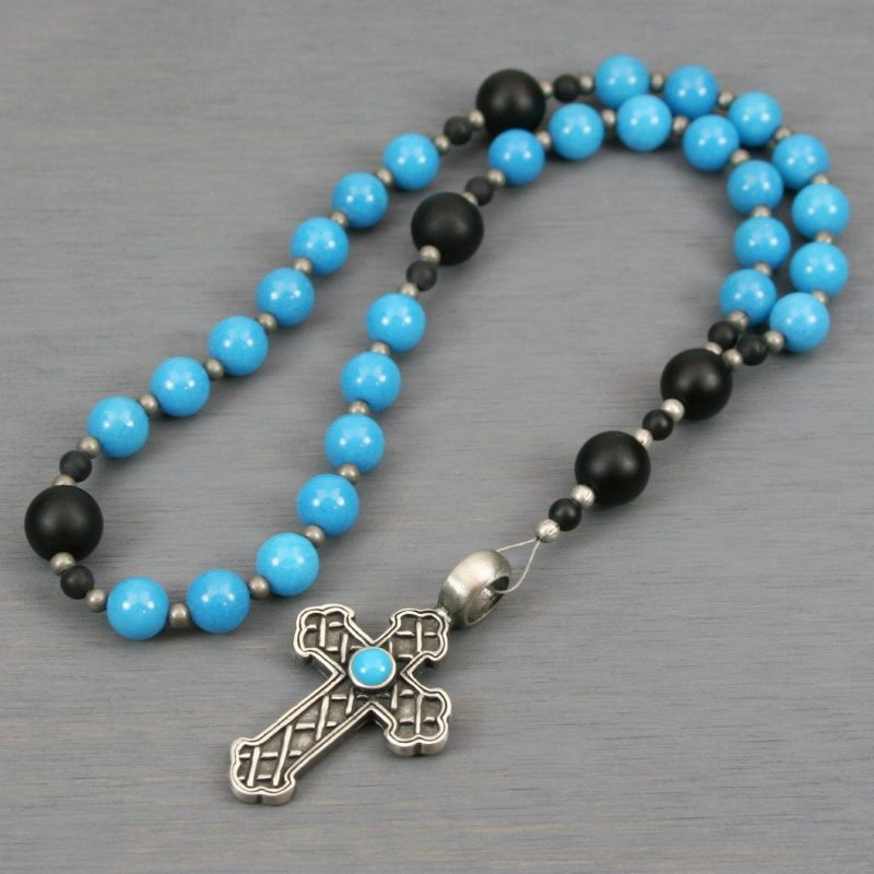 Anglican rosary in turquoise mountain jade and black onyx with a metal cross with a turquoise resin inset