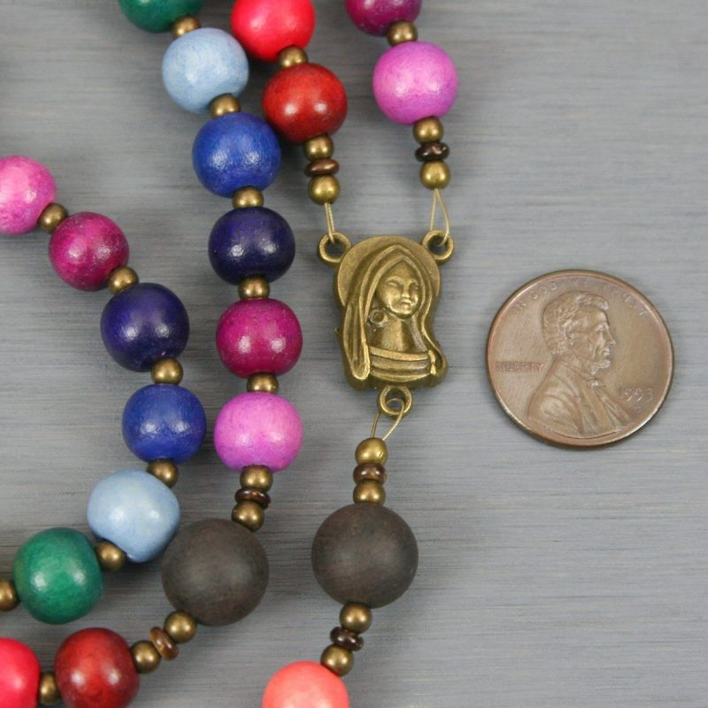 Rainbow wood rosary with antiqued brass crucifix and center in the Roman Catholic style