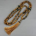 Tiger eye and black onyx hand knotted mala in the Zen style with tassel