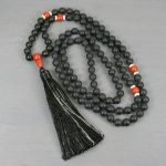 Matte black onyx, red jasper and white bone hand knotted mala in the Zen style with tassel