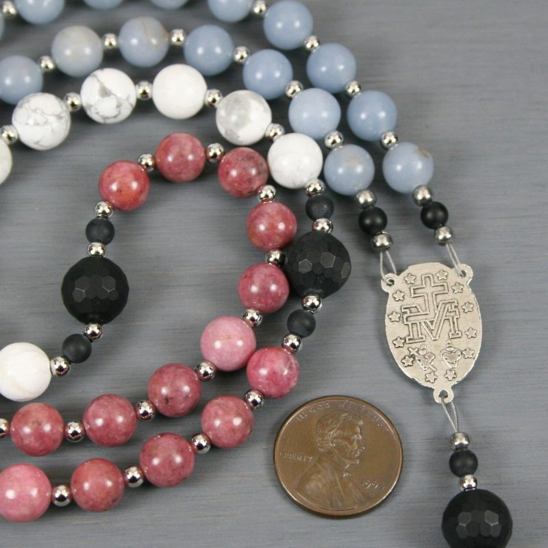 Roman Catholic rosary in blue angelite, rhodonite, and white howlite in a trans flag pattern