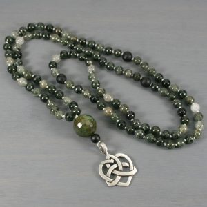 Green rutilated quartz, matte black onyx, and crackle agate hand knotted mala in the Tibetan style with an antiqued pewter Celtic knot heart