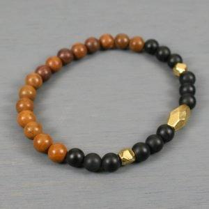 Matte black onyx and tigerskin jasper stretch bracelet with antiqued gold accents