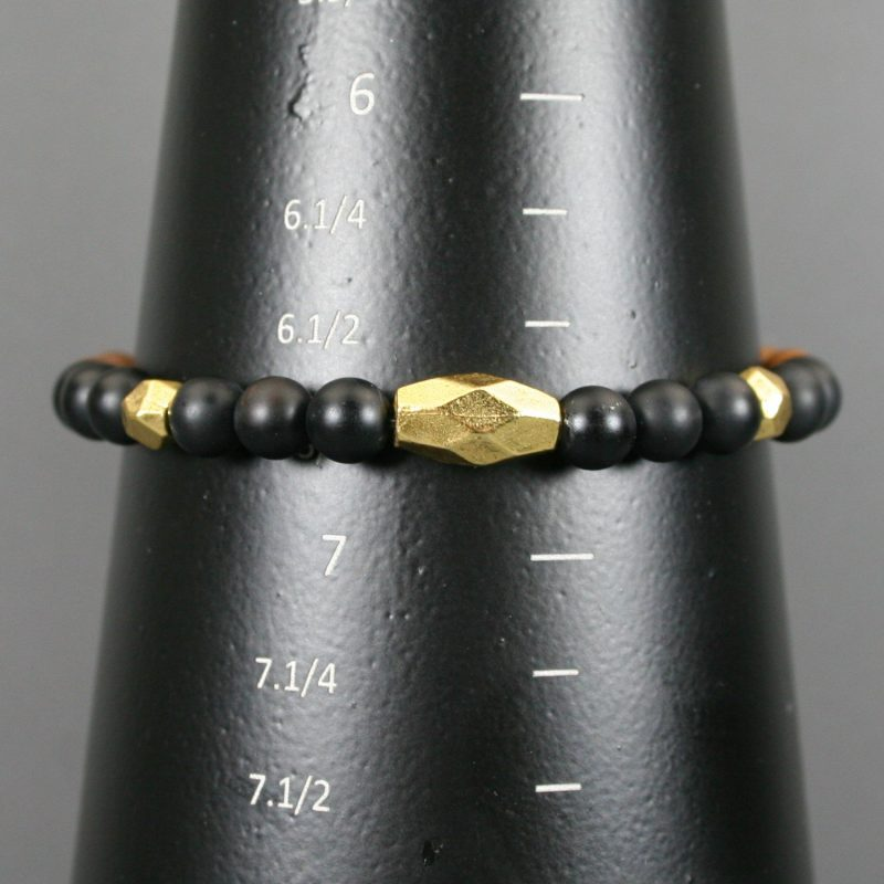 Matte black onyx and tigerskin jasper stretch bracelet with antiqued gold accents