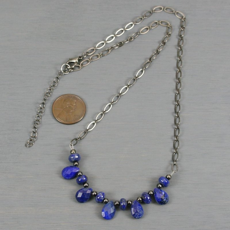 Lapis lazuli necklace with gunmetal accents on gunmetal plated chain