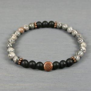 Silver crazy lace agate and matte black onyx stretch bracelet with an antiqued copper spiral focal bead and beaded spacers