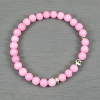 Pink dolomite stretch bracelet with antiqued rhodium plated pewter breast cancer awareness ribbon bead and spacers