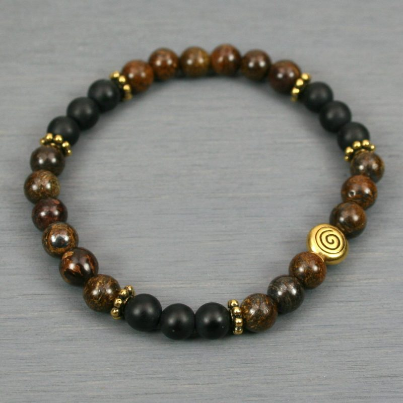 Bronzite and matte black onyx stacking stretch bracelet with an antiqued gold plated spiral accent bead and beaded spacers