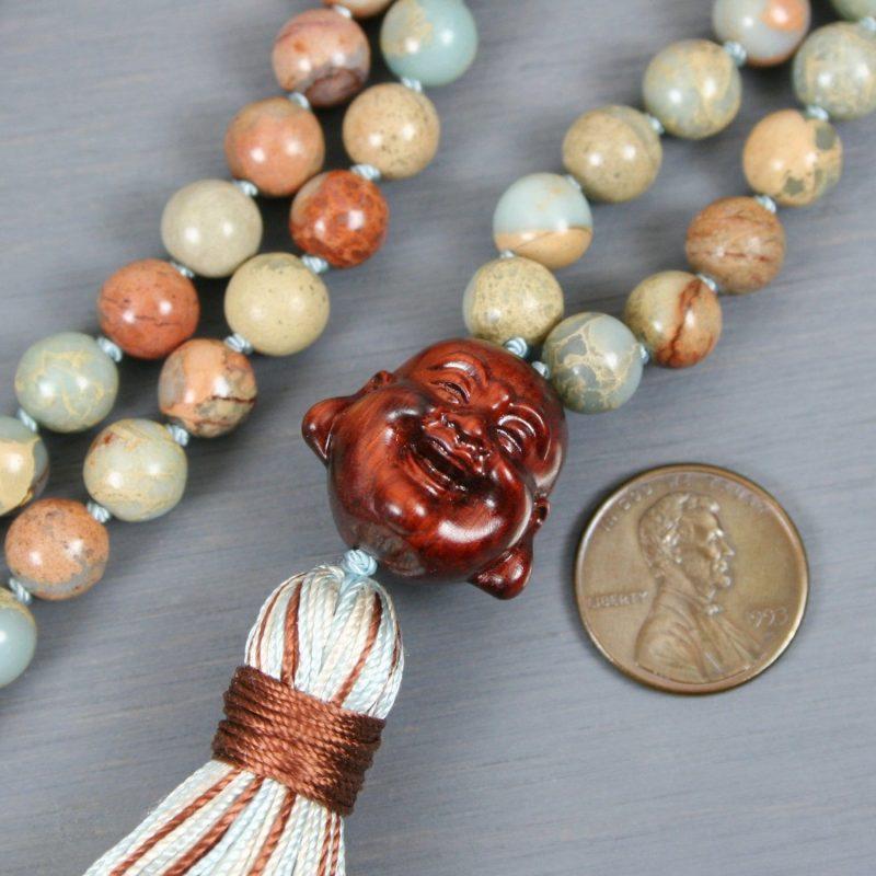 Impression jasper hand knotted mala with a sandalwood happy Buddha guru beads and a multi-color silk tassel