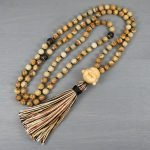 Picture jasper and matte black onyx hand knotted mala in the Tibetan style with a boxwood happy Buddha guru bead and silk tassel