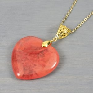 Cherry quartz heart pendant with filigree bail on gold plated cable chain