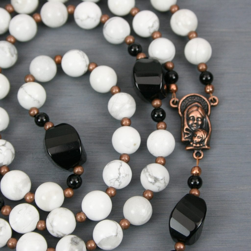 White howlite, black onyx, and antiqued copper rosary in the Roman Catholic style