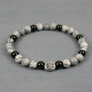 Silver crazy lace agate and obsidian stretch bracelet with Celtic knot accent bead