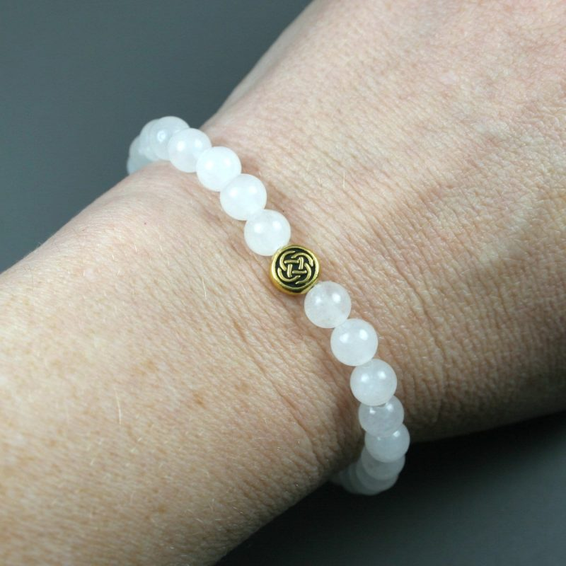 Snow quartz stacking stretch bracelet with antiqued gold plated Celtic knot bead