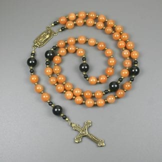 Red aventurine, obsidian, and antiqued brass rosary in the Roman Catholic style with Our Lady of Guadalupe connector