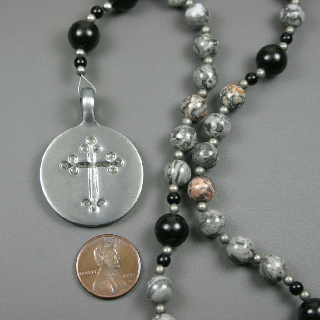 Anglican rosary in silver crazy lace agate and obsidian with an antiqued pewter cross in a circle
