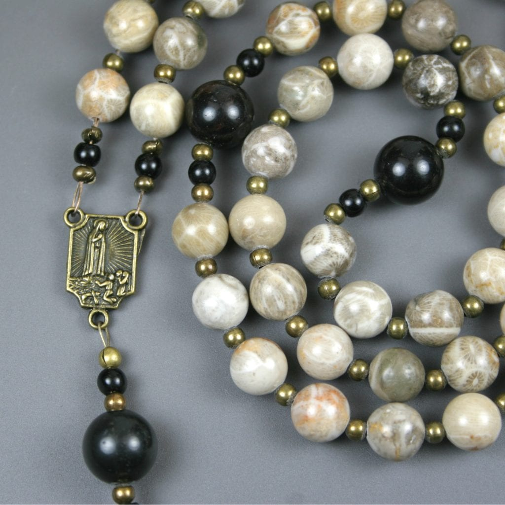 Fossil coral, obsidian, and antiqued brass rosary in the Roman Catholic style