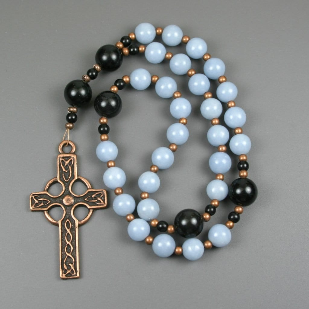 Anglican rosary in blue angelite and obsidian with an antiqued copper Celtic cross