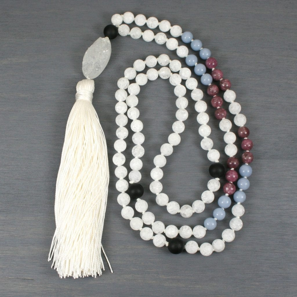 White frosted crackle quartz hand knotted Tibetan style mala with angelite and lepidolite in the trans flag pattern with a silk tassel