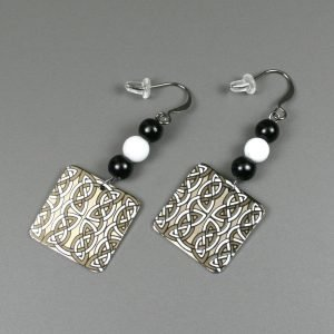 Celtic black and white earrings with obsidian, snow quartz, and a square charm with Celtic designs in black and white on gunmetal ear wires