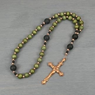 Anglican rosary in olive colored wood, matte black onyx, and copper with a flower decorated copper cross