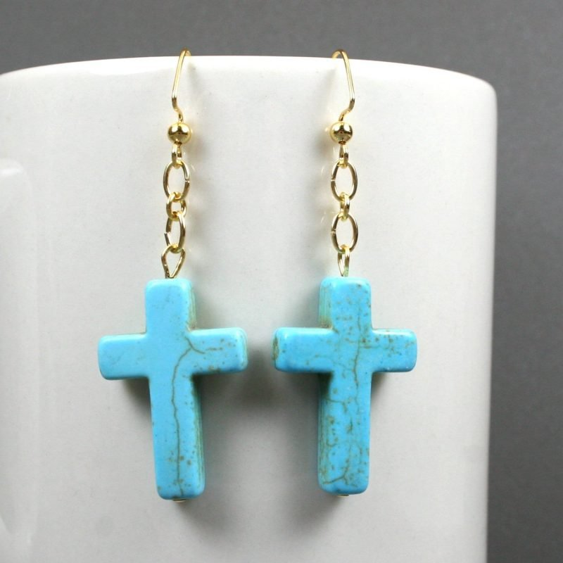 Turquoise howlite stone cross earrings on gold plated ear wires