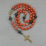 Red jasper, obsidian, and antiqued brass rosary in the Roman Catholic style