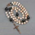 Pink aventurine, black wood, and antiqued copper rosary in the Roman Catholic style