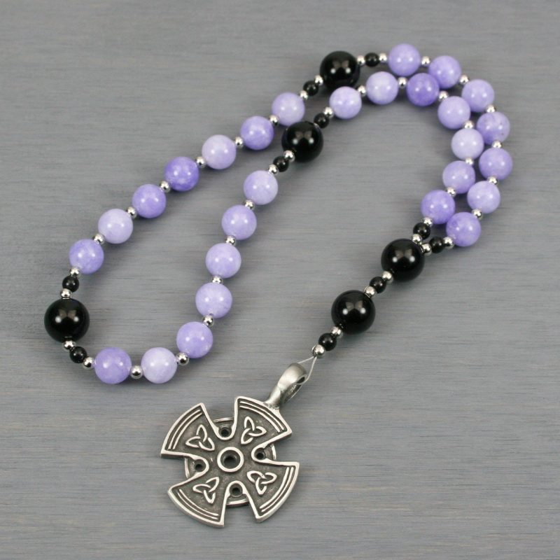 Anglican rosary in lilac jade and obsidian with a pewter cross with Celtic trinity knots