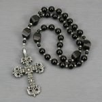 Anglican rosary in black onyx with an antiqued pewter cross