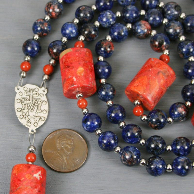 Orange-blue jade, sponge coral, and silver rosary in the Roman Catholic style