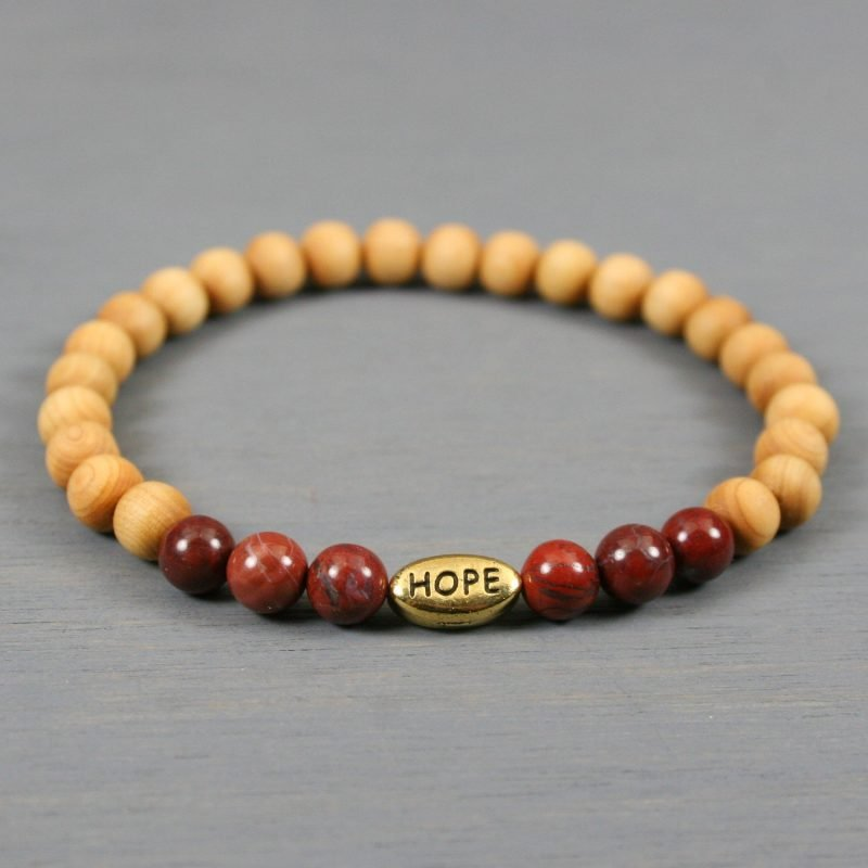 Brecciated jasper and thuja sutchuenensis wood stretch bracelet with an antiqued gold plated HOPE bead