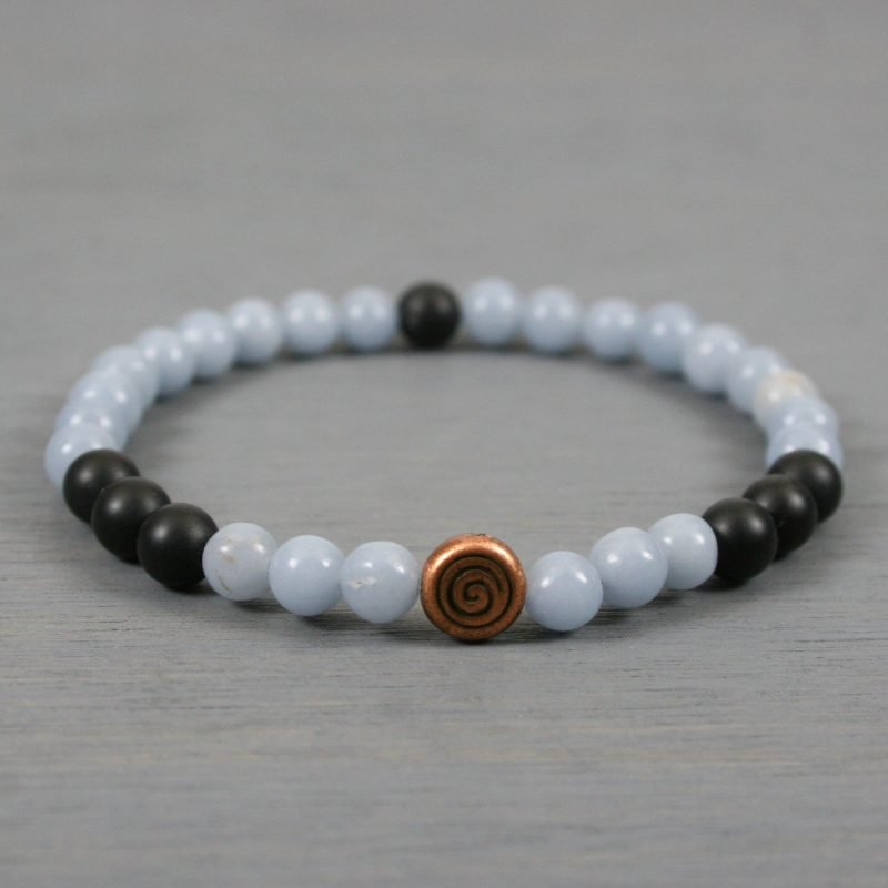Blue angelite and matte black onyx stretch bracelet with an antiqued copper spiral focal