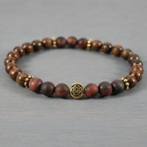 Matte red tiger eye and tiger skin sandalwood stretch bracelet with a Celtic knot focal bead
