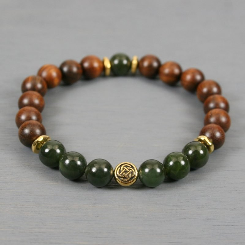 Nephrite jade and palisander wood stretch bracelet with a gold Celtic knot focal