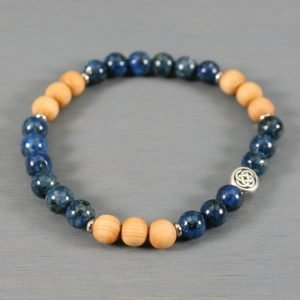 Blue sesame jasper and wood stretch bracelet with a Celtic knot focal bead