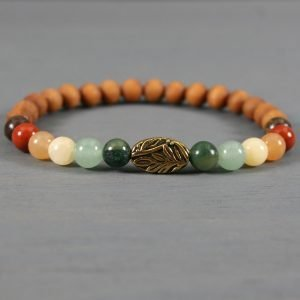 Ombre autumn color stone and sandalwood stretch bracelet with antiqued gold plated leaf accent bead